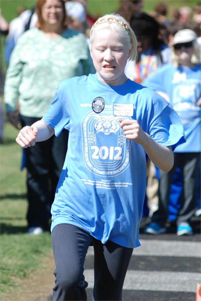 Roby Games: Young lady running a race.