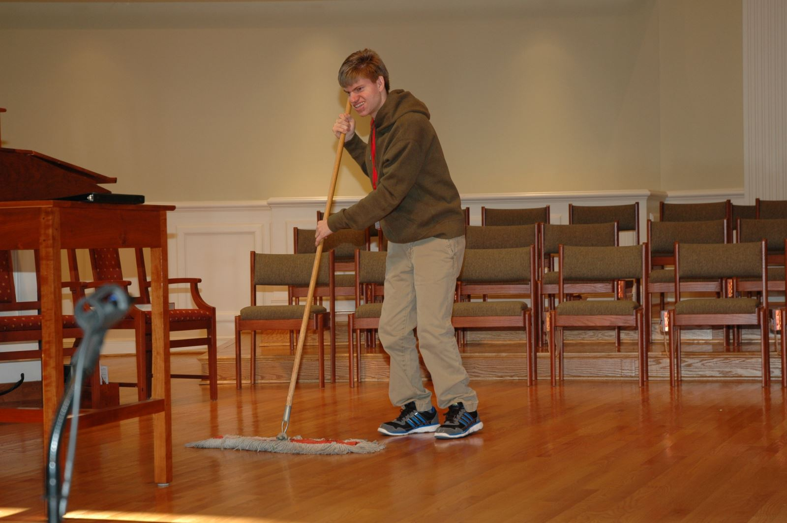 Student mopping floor.