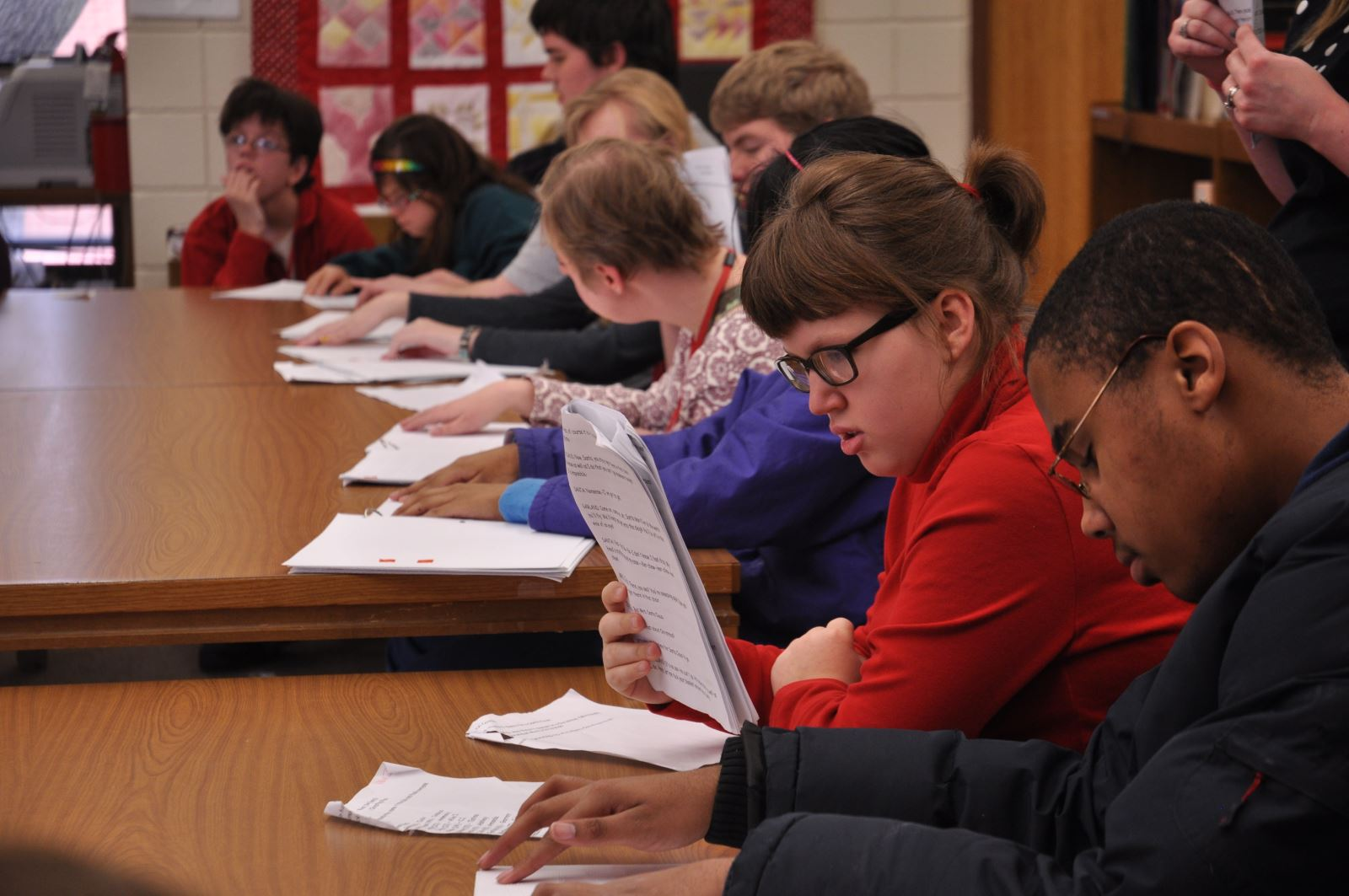 Students reading in a various formats.