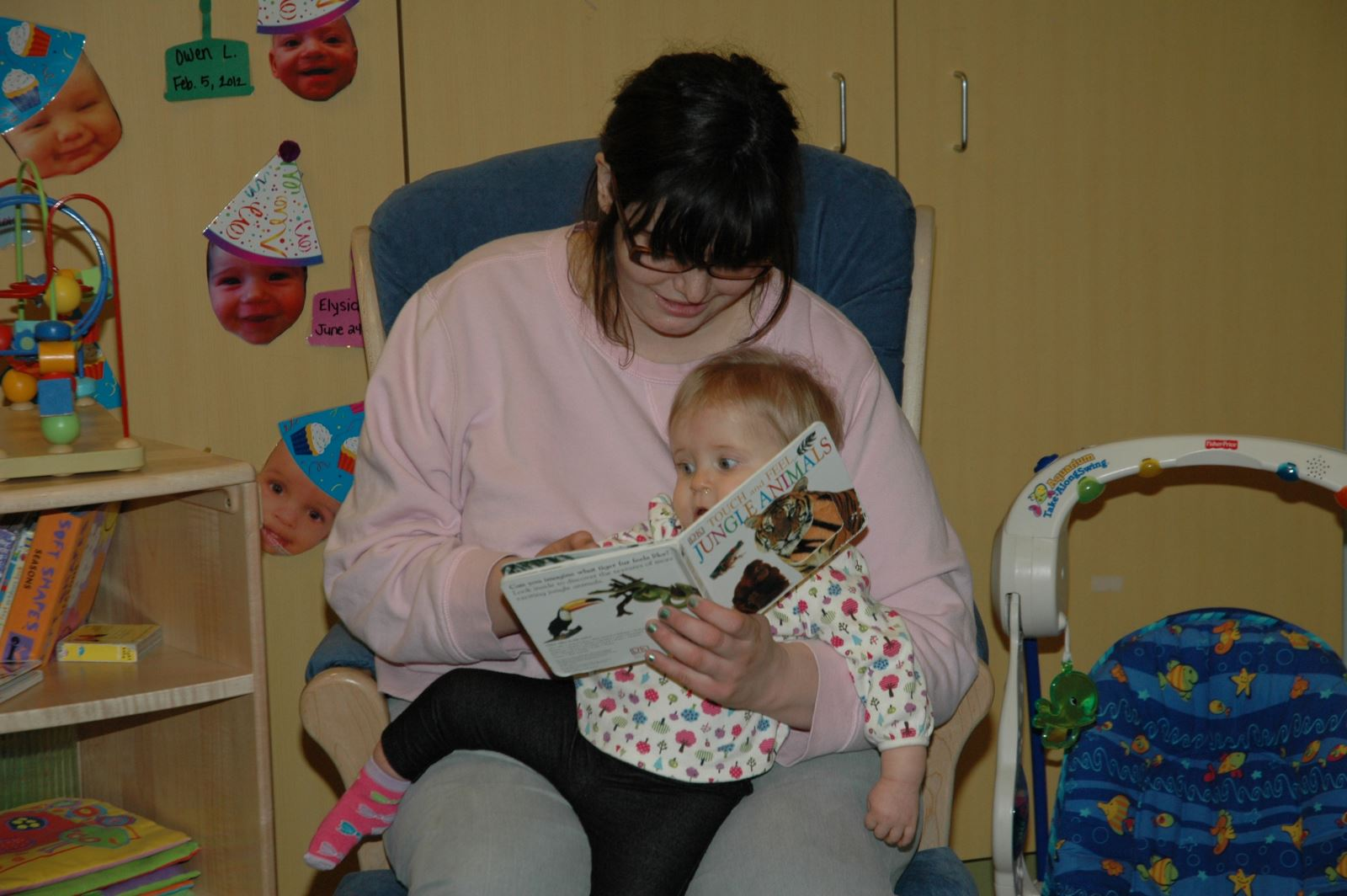 Student reading to small child.